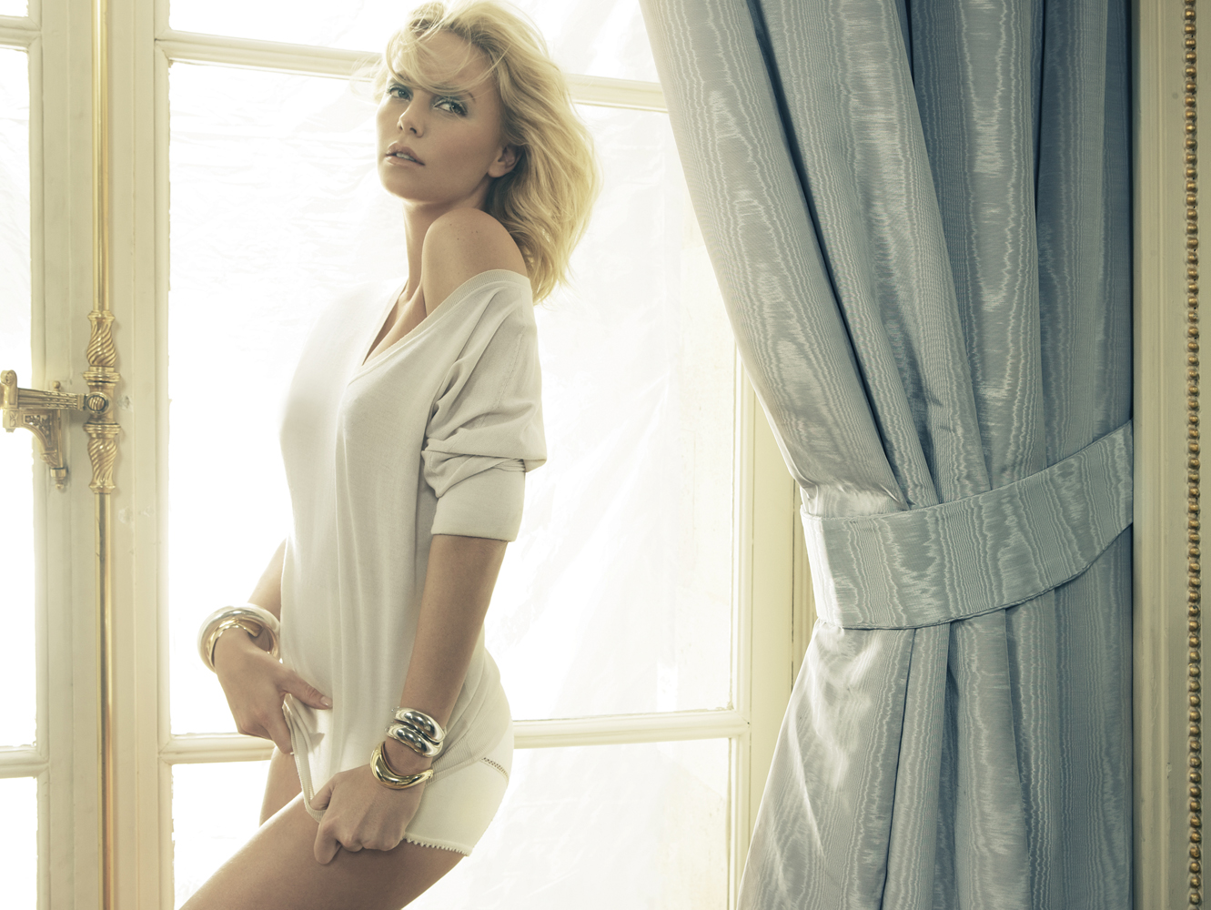 Charlize Theron photoshoot wearing a knit shirt