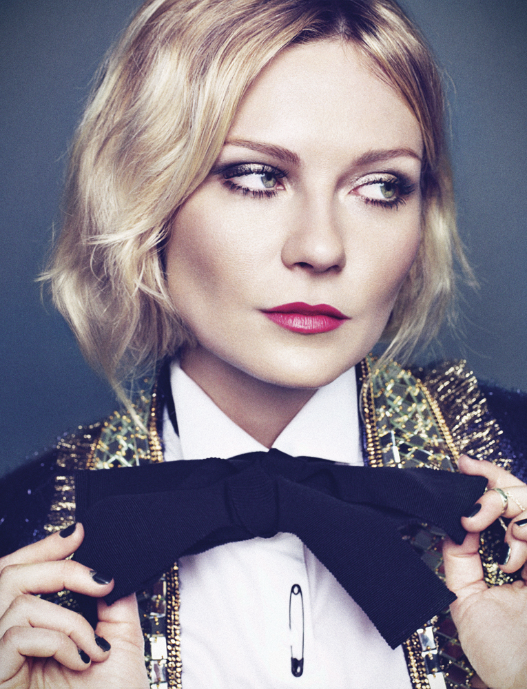 Kirsten Dunst wearing a suit and bowtie