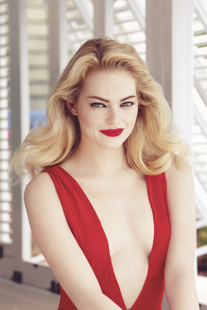 Emma Stone wearing a red dress with a deep neckline