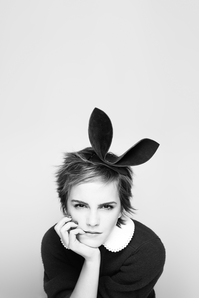Emma Watson wearing a black top and rabbit ears
