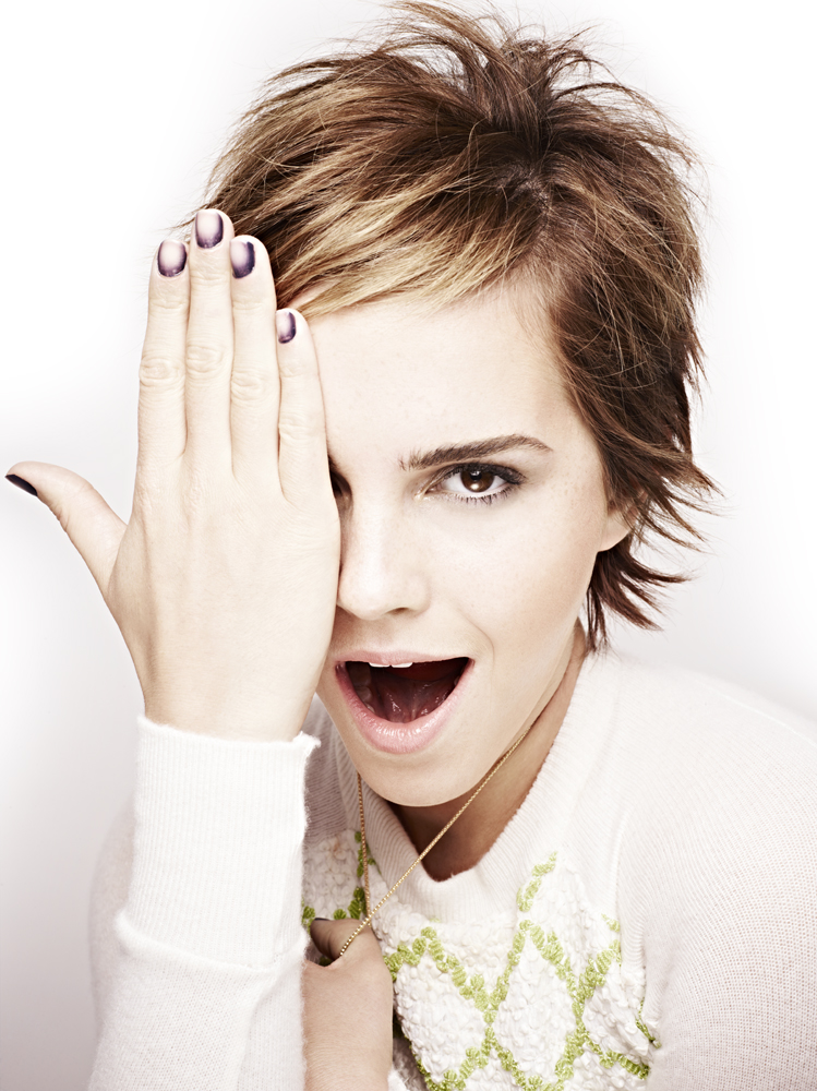 Emma Watson wearing a printed top and nail art