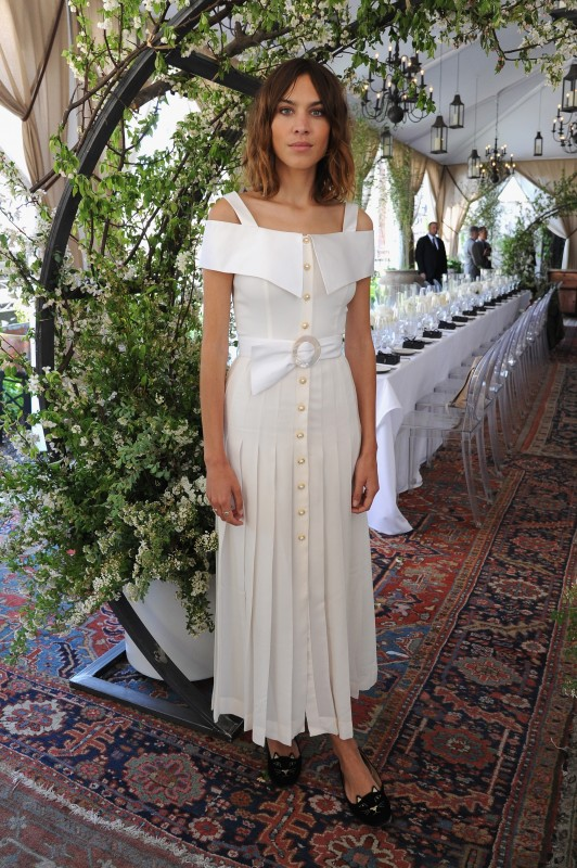 Alexa Chung red carpet white Alessandra Rich off-shoulder dress and Charlotte Olympia kitty flats