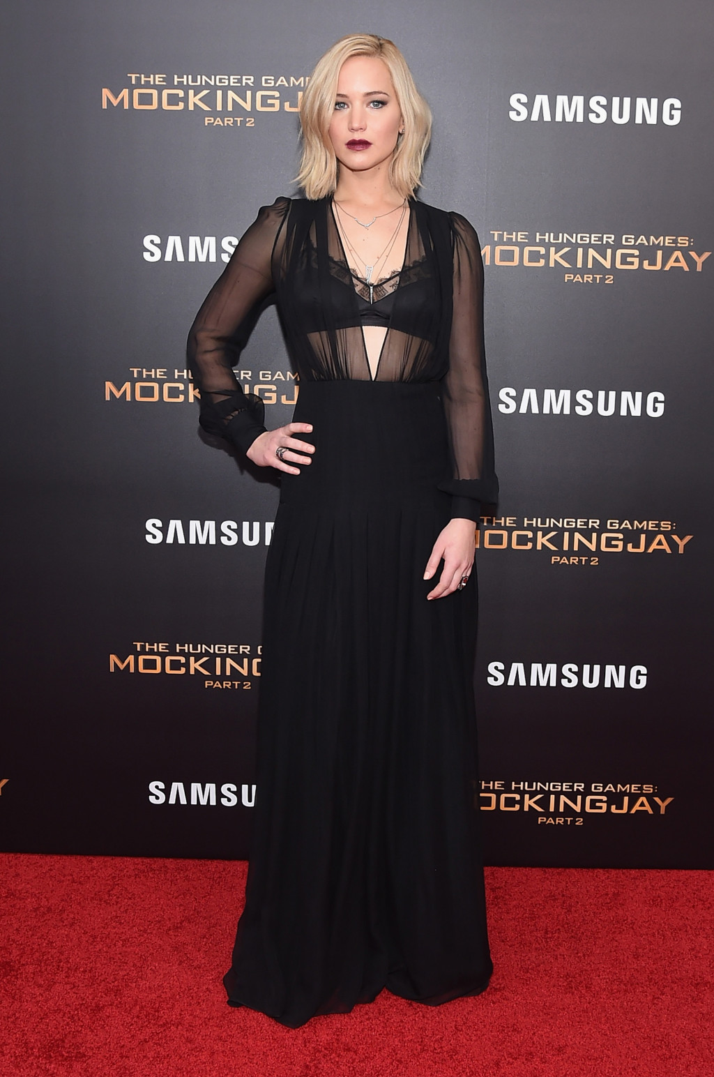 Jennifer Lawrence in a black sheer Schiaparelli Couture gown
