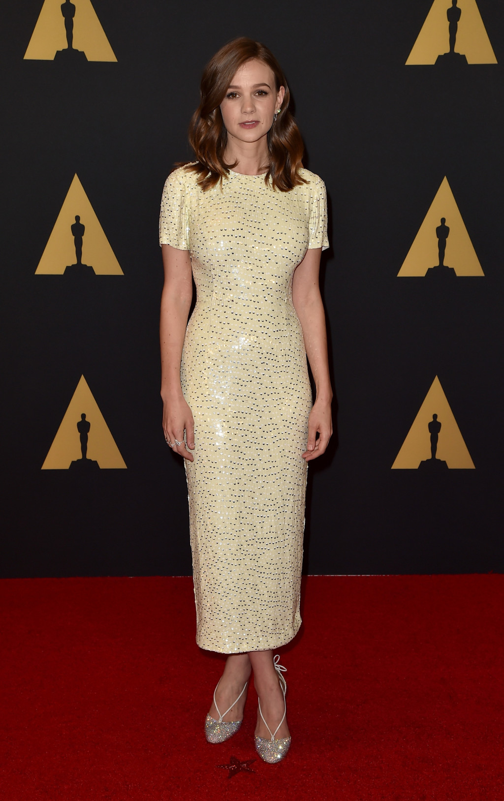 Carey Mulligan in a yellow sequined Jonathan Saunders dress