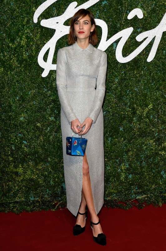 Alexa Chung red carpet silver metallic Emilia Wickstead dress and Charlotte Olympia takeout bag at the British Fashion Awards