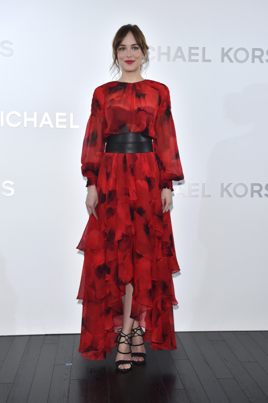 Dakota Johnson in a red printed and ruffled Michael Kors dress