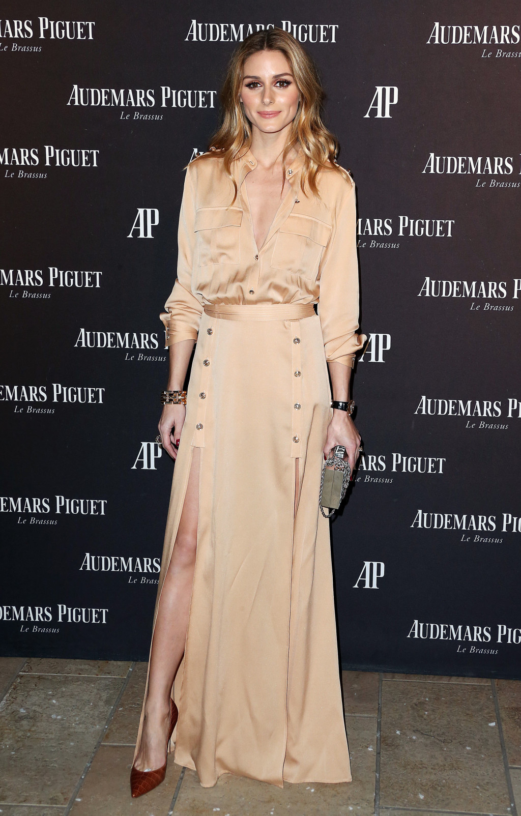 Olivia Palermo wearing a metallic gold Self-Portrait dress at the Audemars Piguet boutique opening