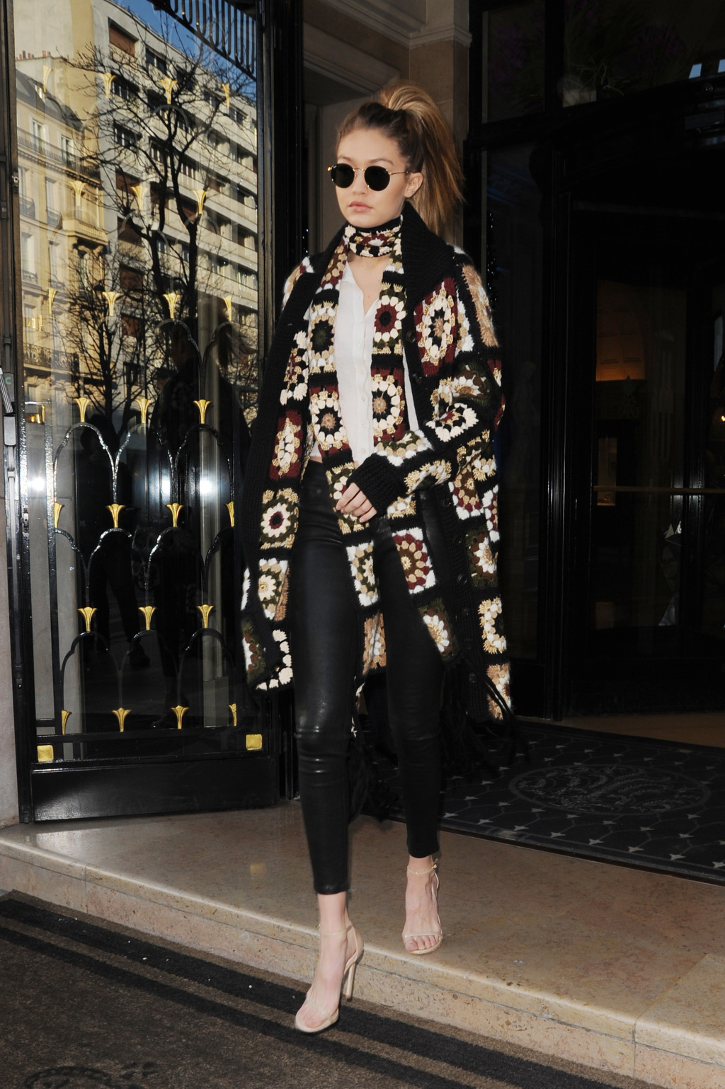 Gigi Hadid in an embroidered cardigan and black leggings