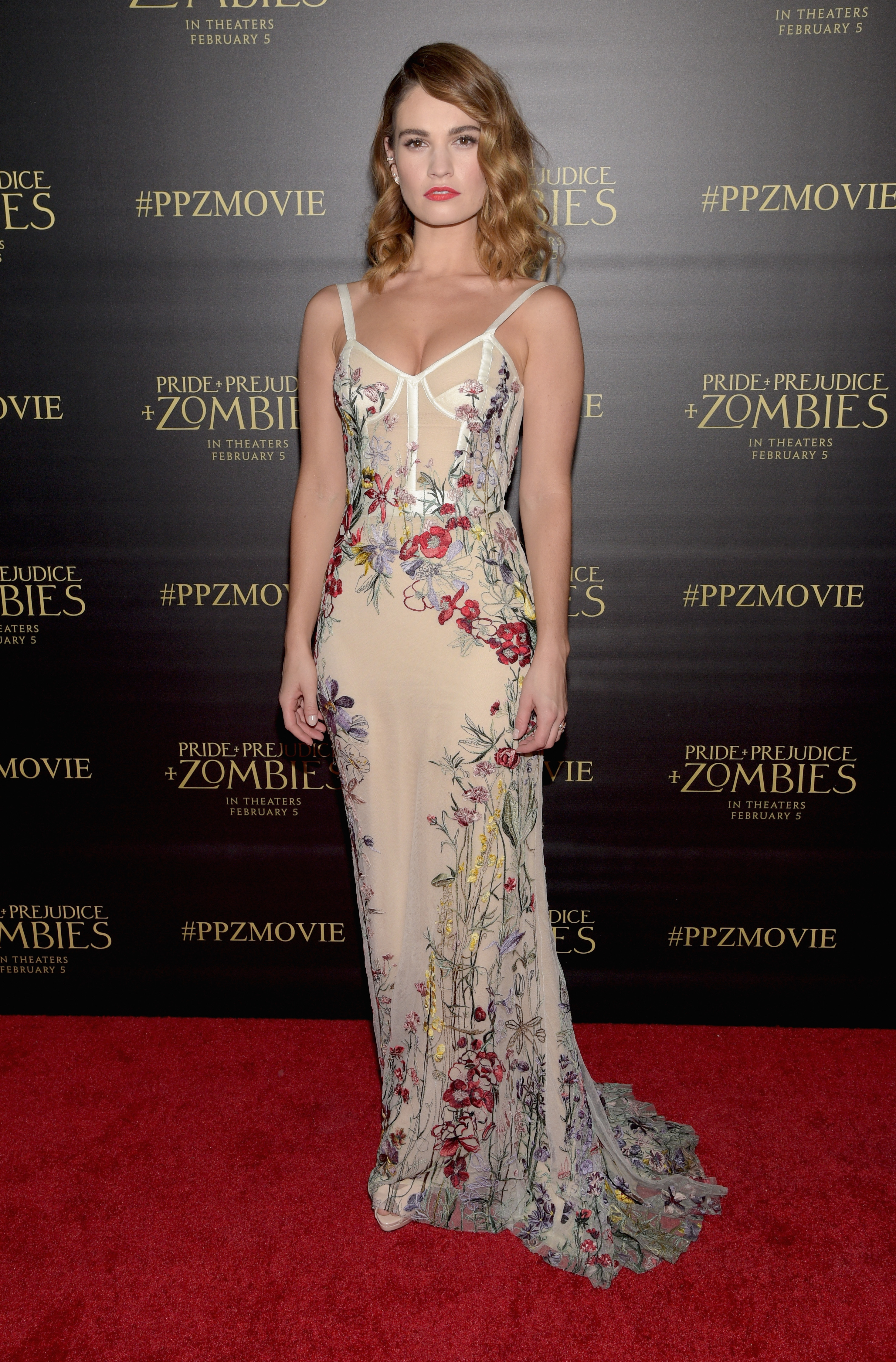 Lily James in a nude floral Alexander McQueen dress at the Prejudices and Zombies premiere