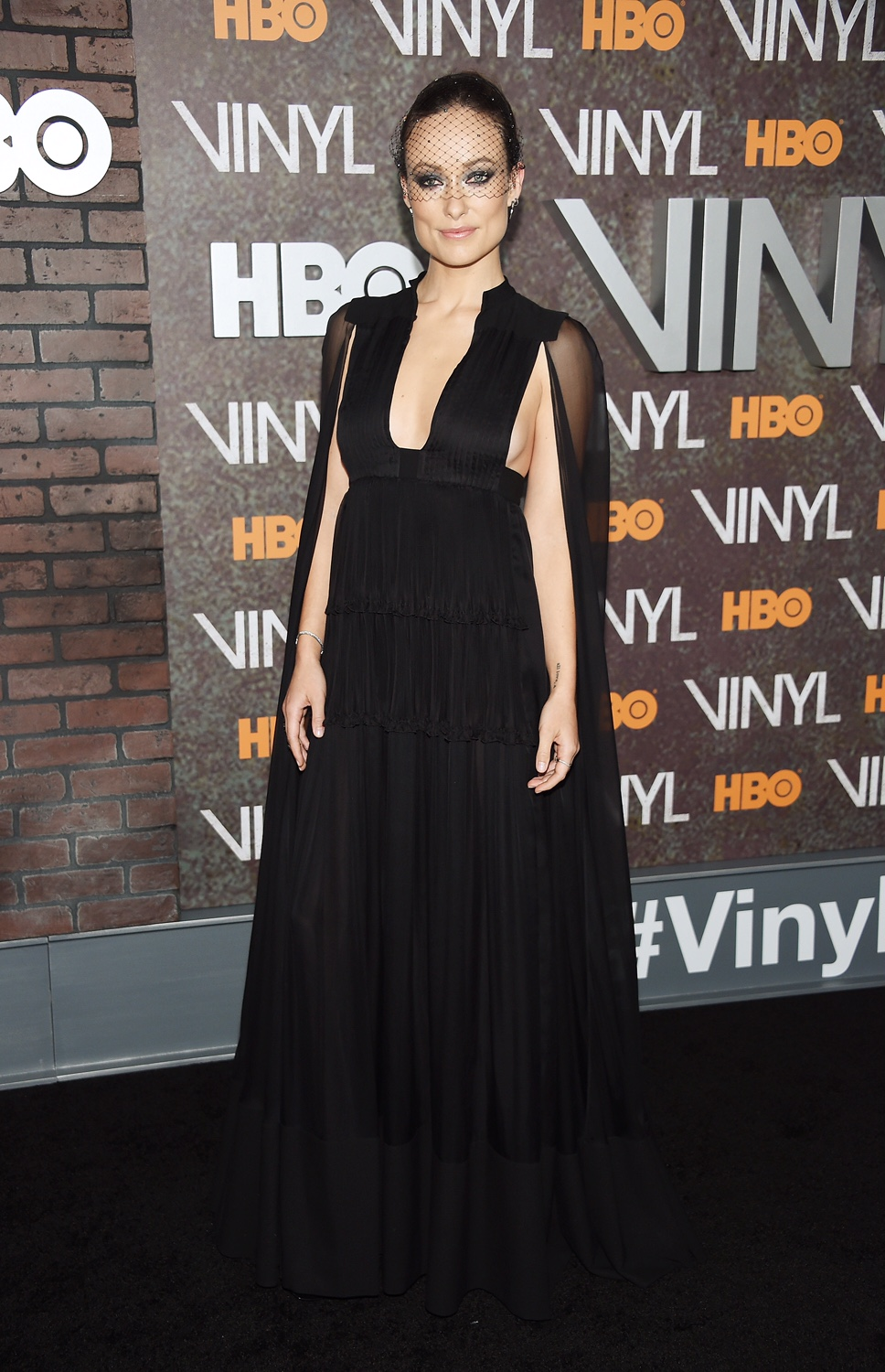 Olivia Wilde in a black Valentino gown at the Vinyl premiere