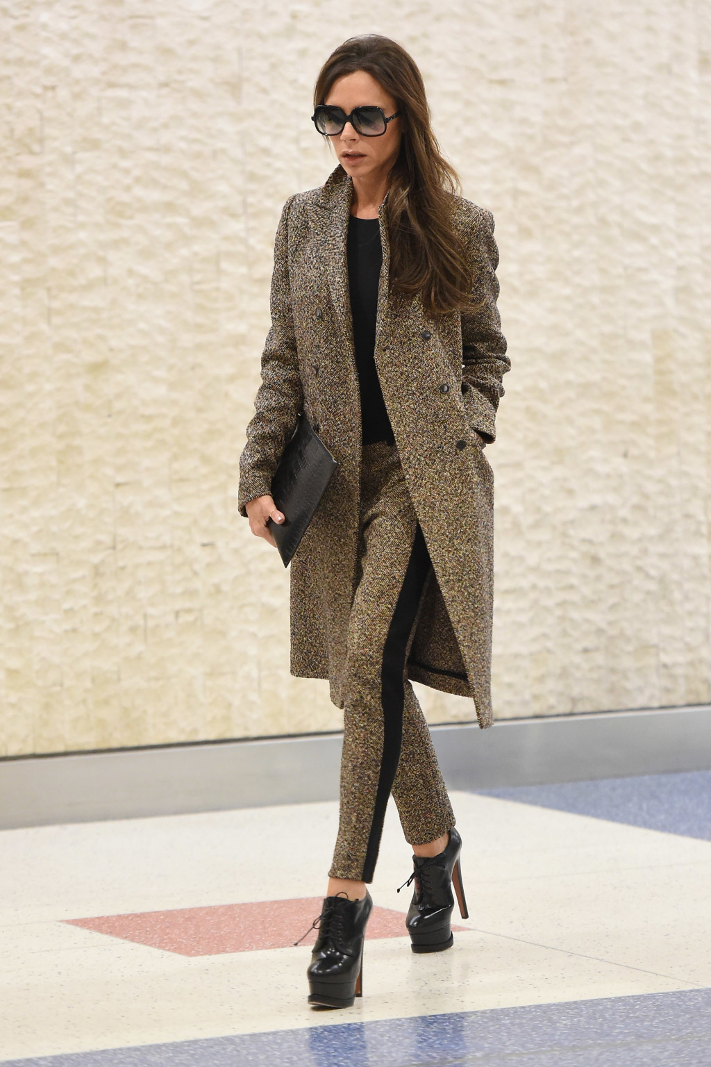 Victoria Beckham arrives at JFK airport in NYC.