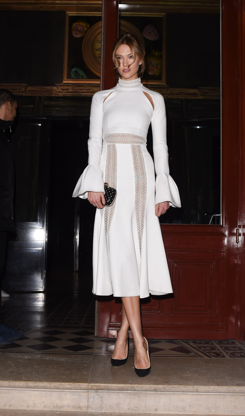 Karlie Kloss in a white Jonathan Simkhai dress at the L'Oreal party in Paris
