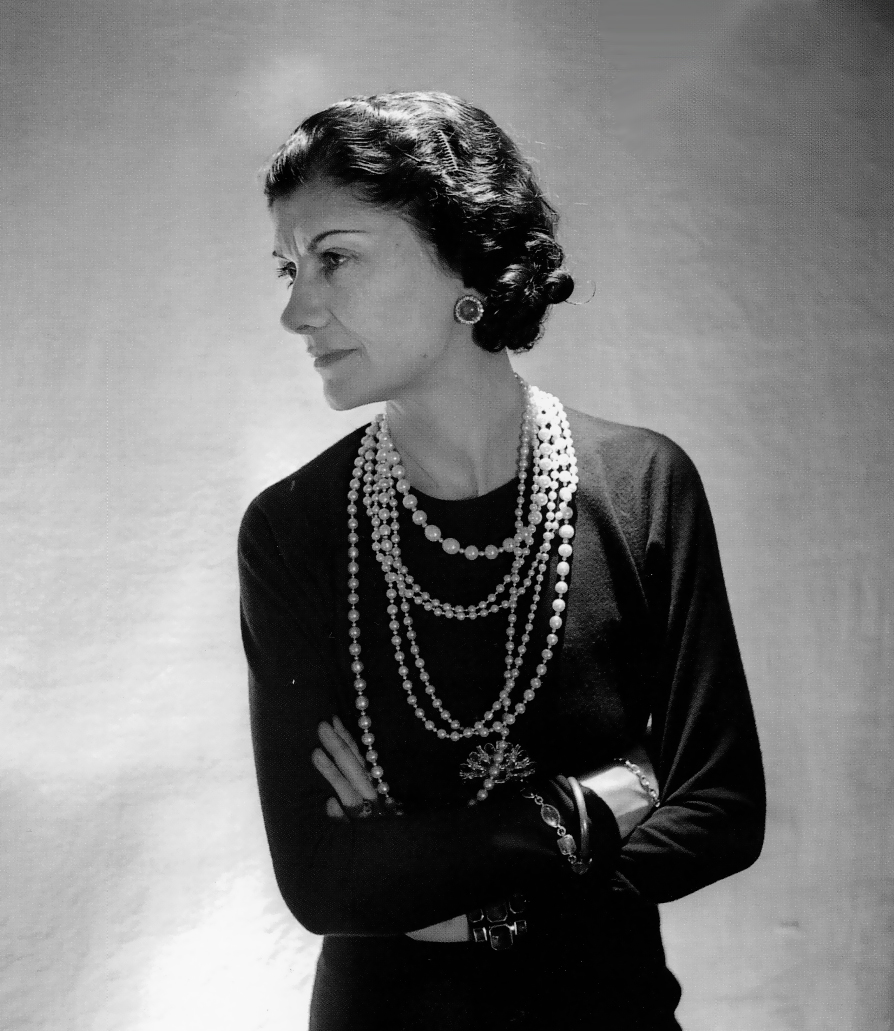 Coco Chanel black dress pearl necklace