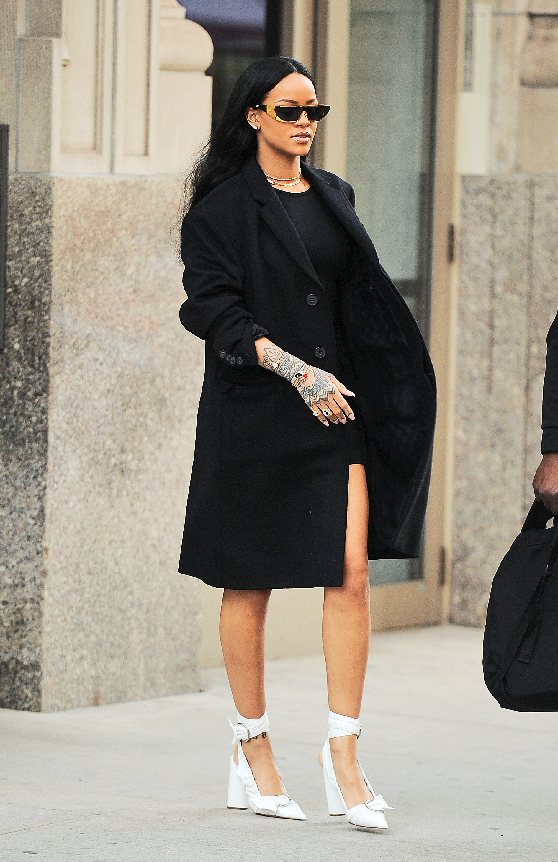 Rihanna looks like a fashionista as she heads out of her apartment in NYC