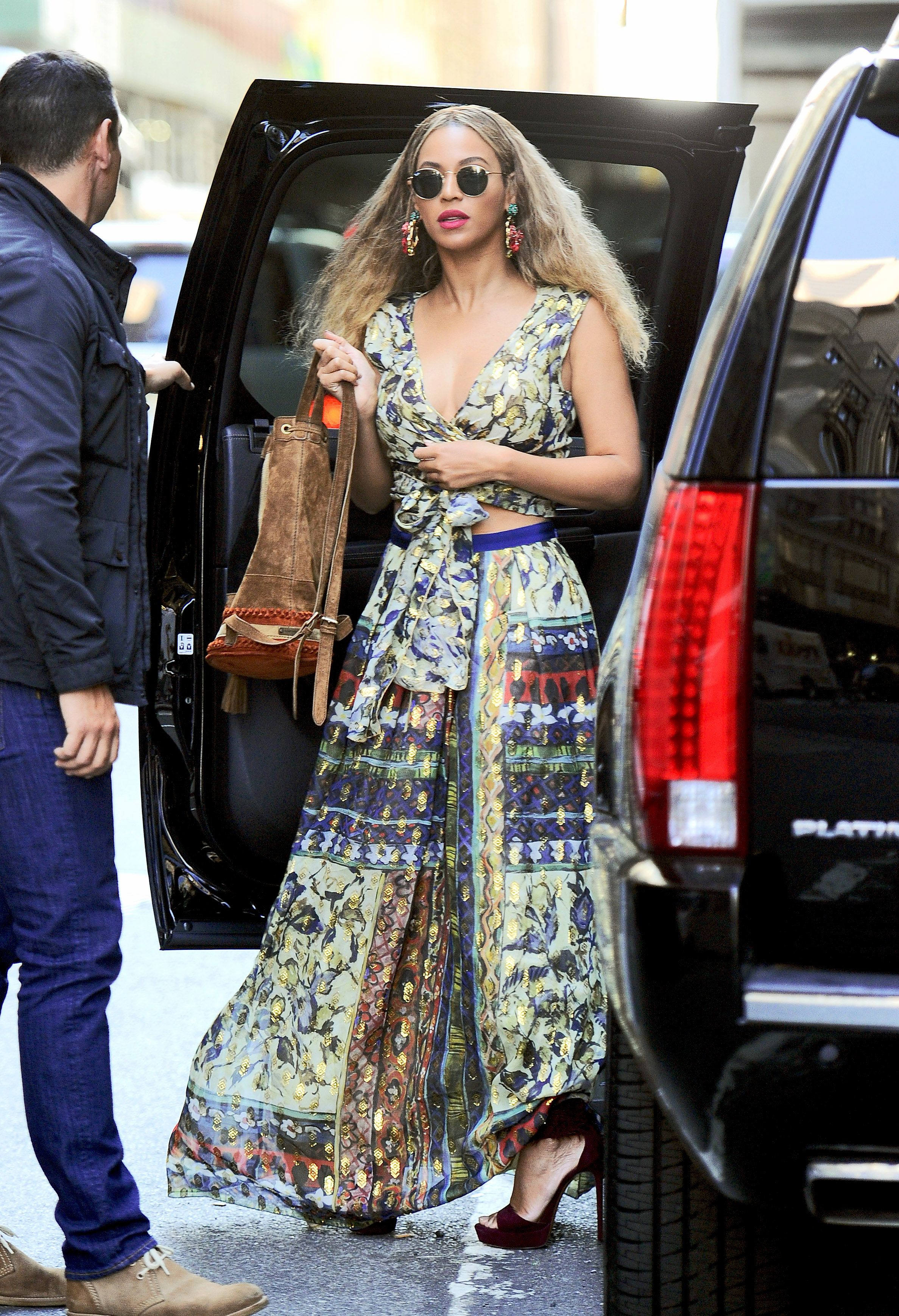 Beyonce looks stunning wearing a floral gown as she heads to her office in NYC
