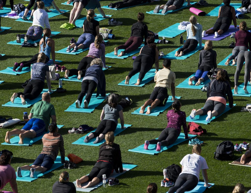 A general view of a bootcamp and yoga workout as Fitbit Local Minneapolis launches at with a free event at Target Field on October 1, 2016 in Minneapolis, Minnesota.