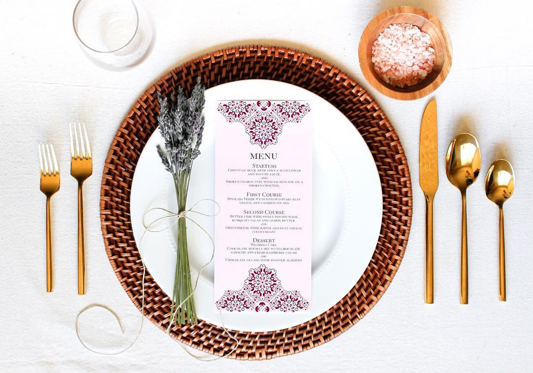 close up of white pink wedding menu gold cutlery