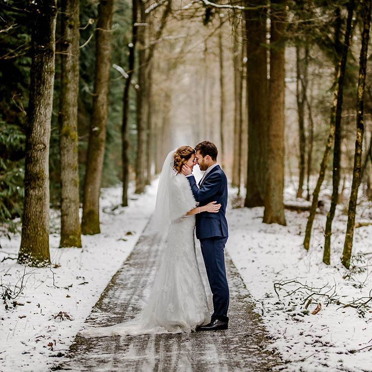 winter wedding forest snow trees bride groom