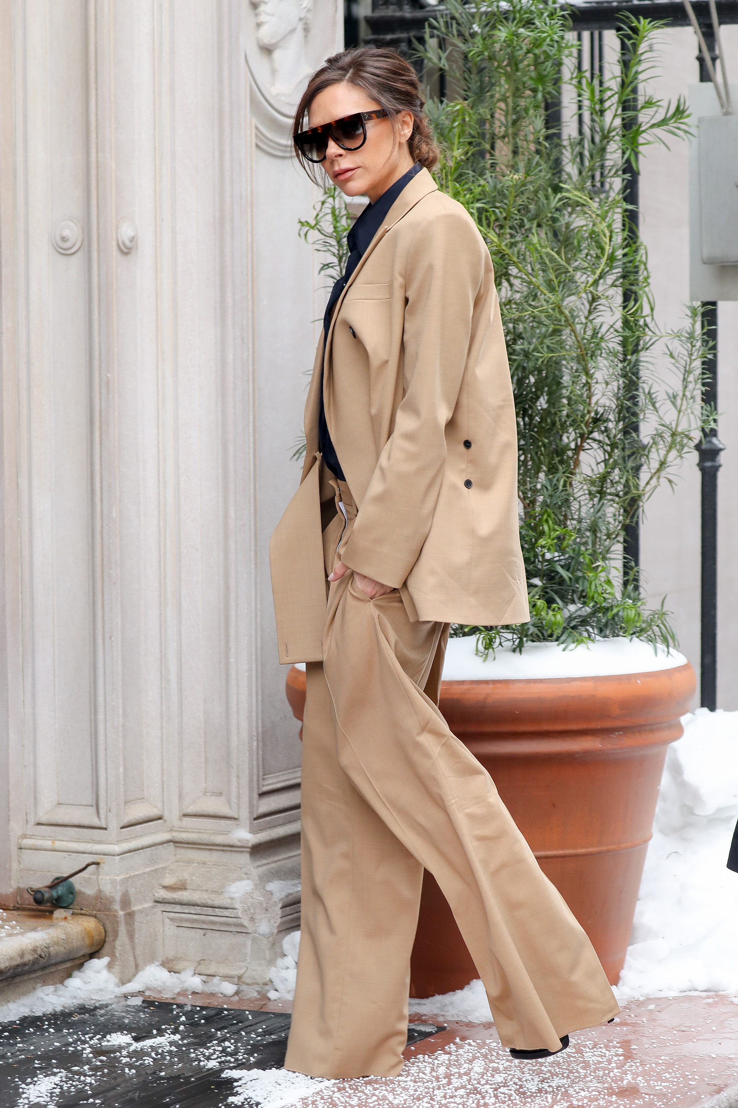 Fashionable Victoria Beckham wore a beige trouser suit while heading for a meetings in Midtown, New York City