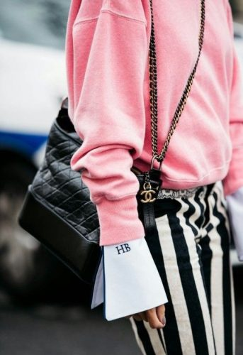 Chanel bag and striped trousers street style look