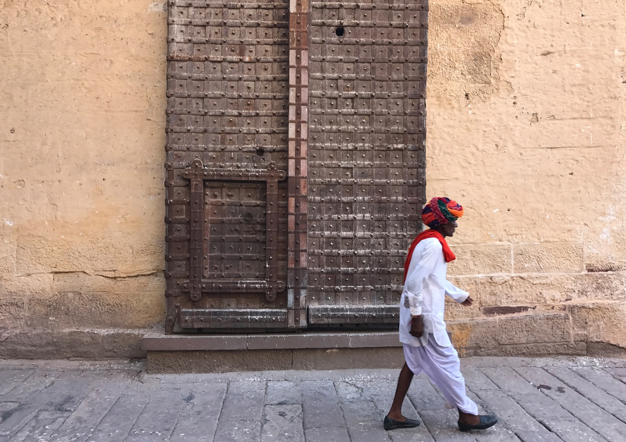 indian man walking ancient door MONTROI RAJASTHAN 7