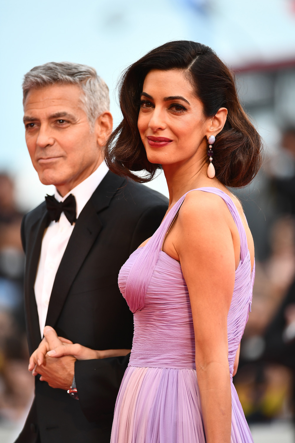 VENICE, ITALY - SEPTEMBER 02: George Clooney and Amal Clooney walk the red carpet ahead of the 'Suburbicon' screening during the 74th Venice Film Festival at Sala Grande on September 2, 2017 in Venice, Italy. (Photo by Ian Gavan/Getty Images)