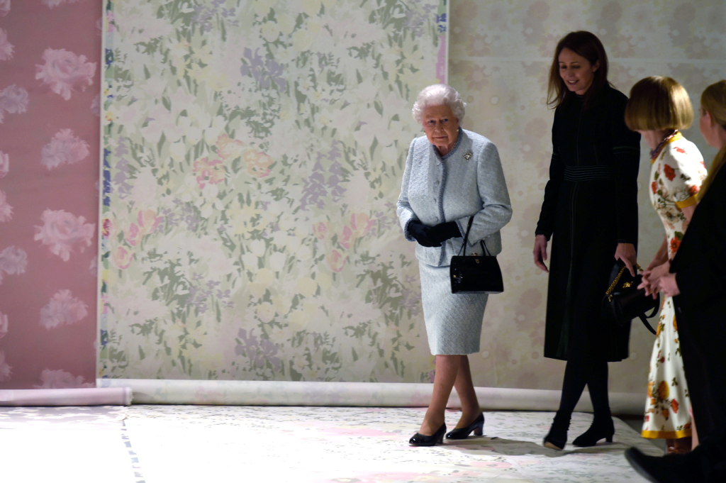 Queen Elizabeth arrives with Caroline Rush to Richard Quinn's Fall/Winter 2018 show at London Fashion Week