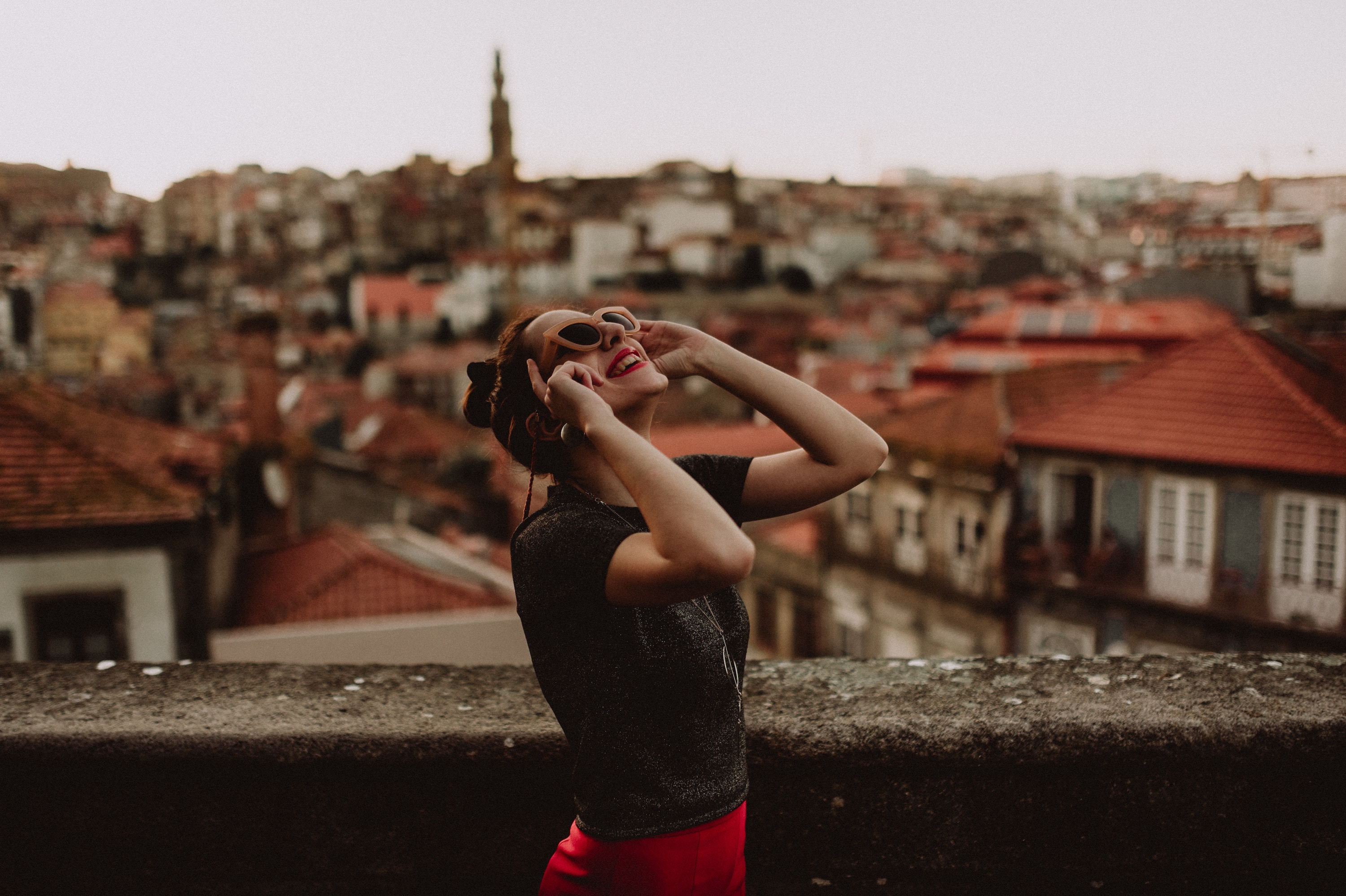 happy woman city kinga cichewicz unsplash