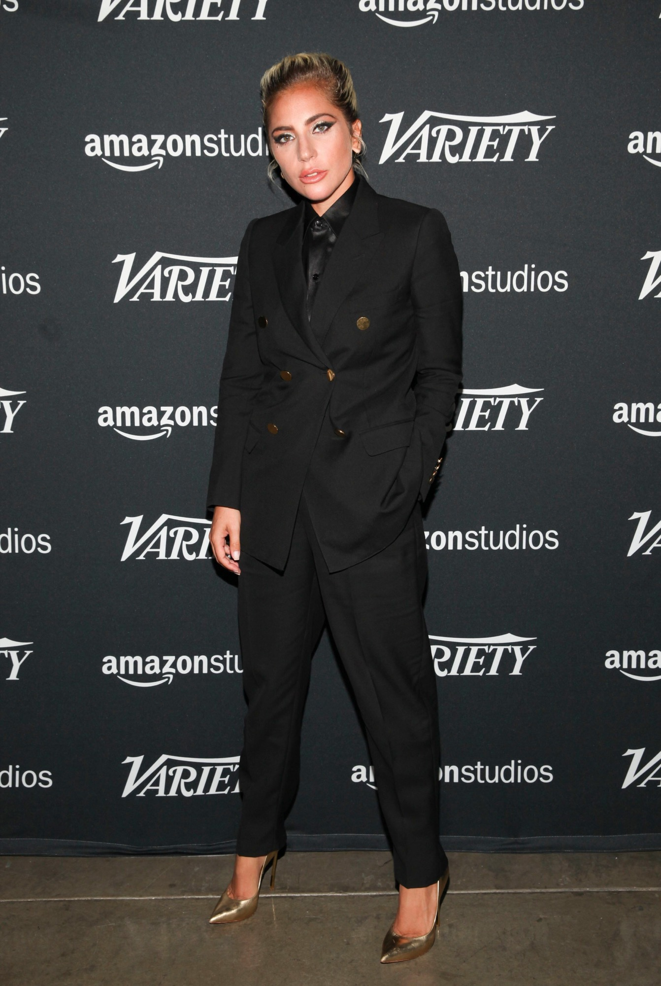 Lady Gaga in black suit designed by hedi slimane for celine