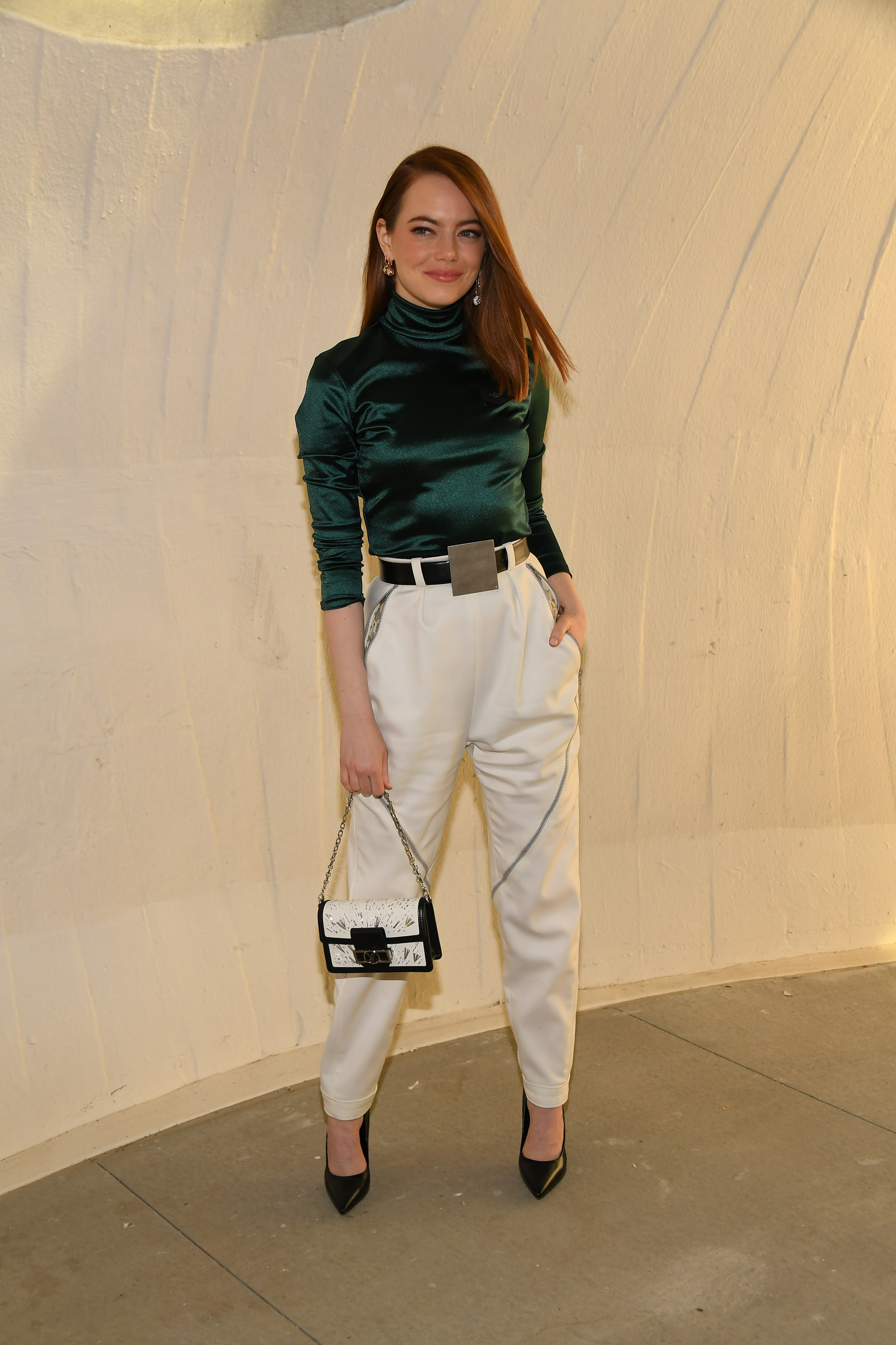 NEW YORK, NEW YORK - MAY 08: Emma Stone attends the Louis Vuitton Cruise 2020 Fashion Show at JFK Airport on May 08, 2019 in New York City. (Photo by Nicholas Hunt/Getty Images for Louis Vuitton)