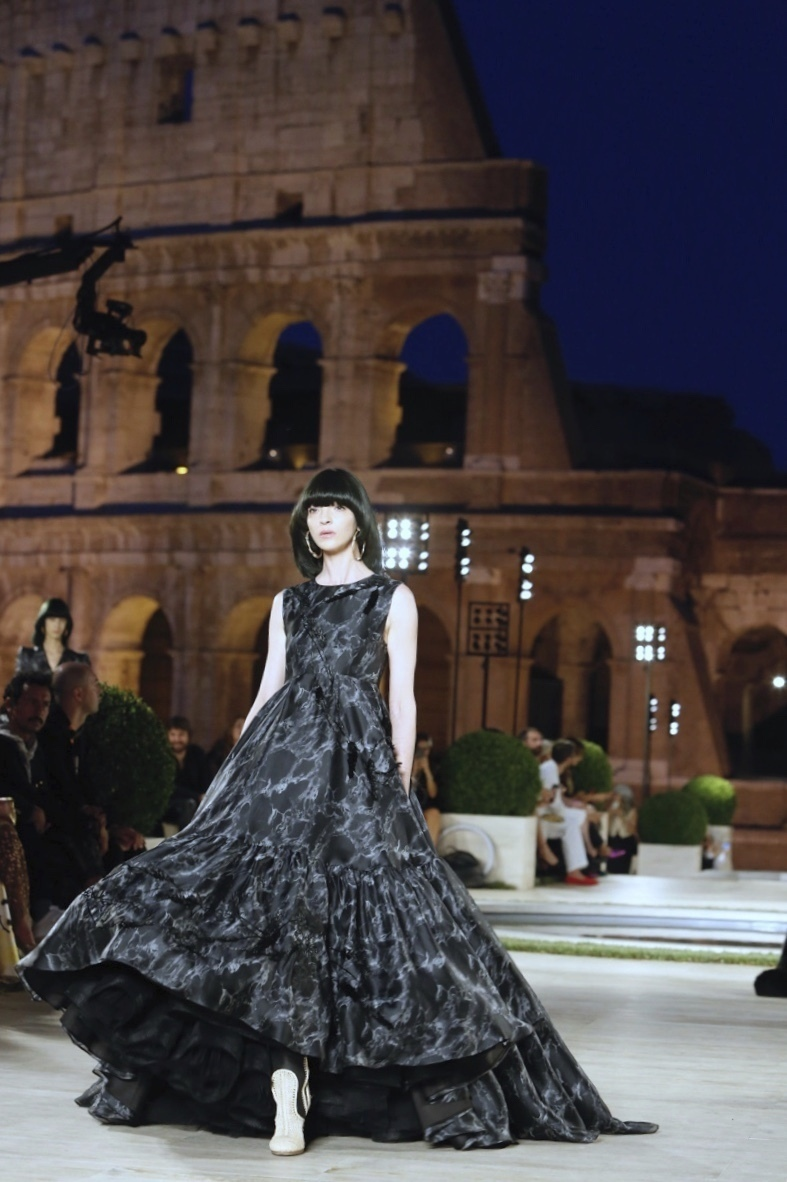 A model for Fendi presents the Fall-Winter 2019-2020 collection 'The dawn of Romanity' during a couture runaway show in front of Rome's Colosseum,Thursday, Jul. 4, 2019. The show is meant to pay homage to fashion designer Karl Lagerfeld who passed away early this year at 85, ending his 54-year tenure with the luxury brand. (AP Photo/Domenico Stinellis)