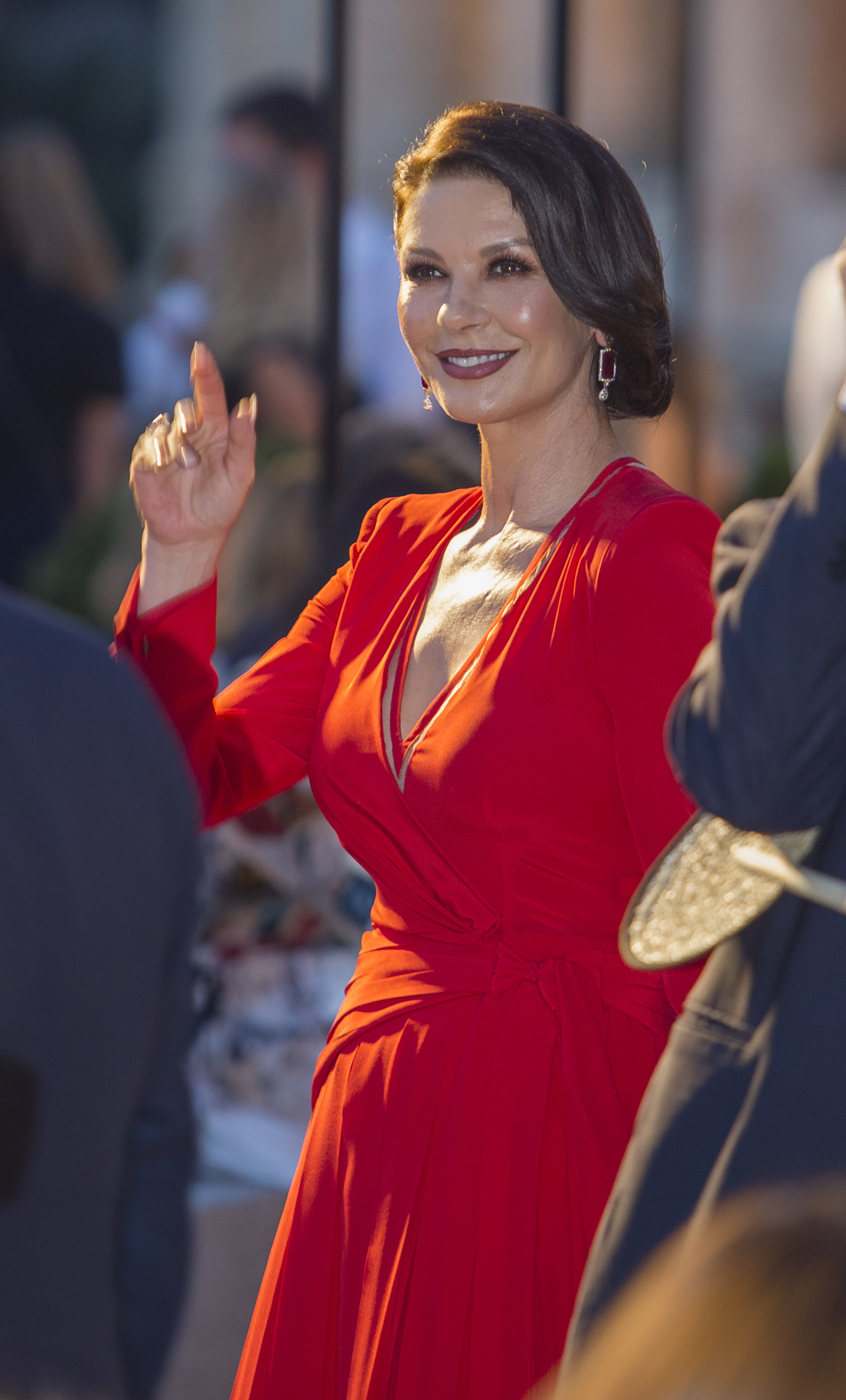 Actress Catherine Zeta-Jones waves before the start of Fendi's Fall-Winter 2019-2020 show 'The dawn of Romanity' during a couture runaway show in front of Rome's Colosseum,Thursday, Jul. 4, 2019. The show is meant to pay homage to fashion designer Karl Lagerfeld who passed away early this year at 85, ending his 54-year tenure with the luxury brand. (AP Photo/Domenico Stinellis)