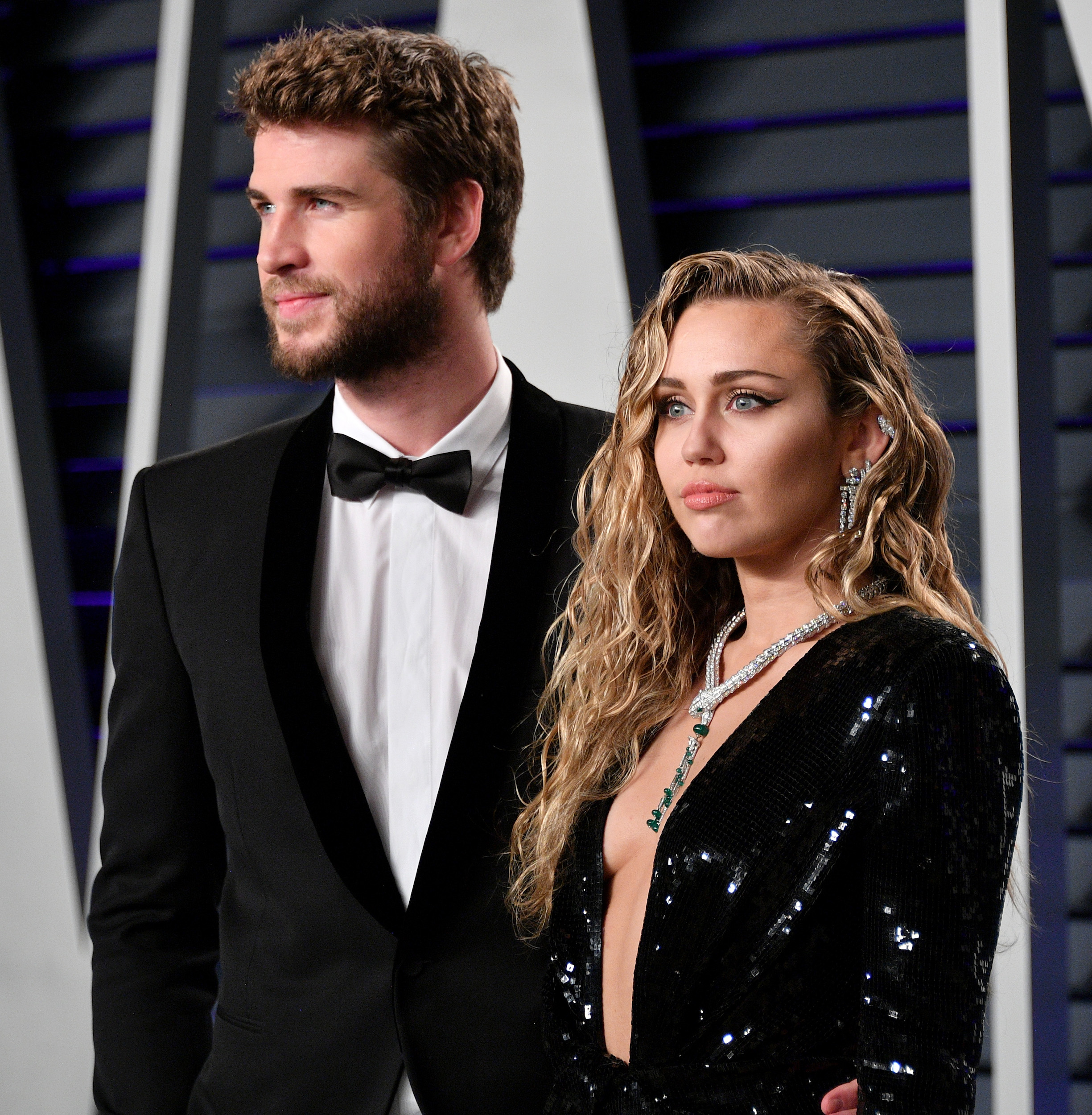 Liam Hemsworth and Miley Cyrus attend the 2019 Vanity Fair Oscar Party hosted by Radhika Jones at Wallis Annenberg Center for the Performing Arts on February 24, 2019 in Beverly Hills, California.