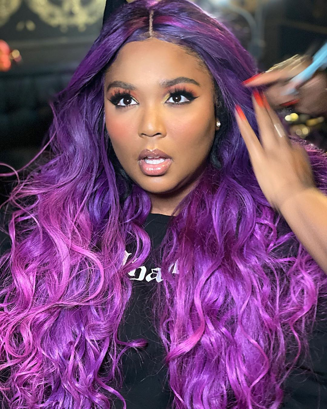 Lizzo purple wig beauty look
