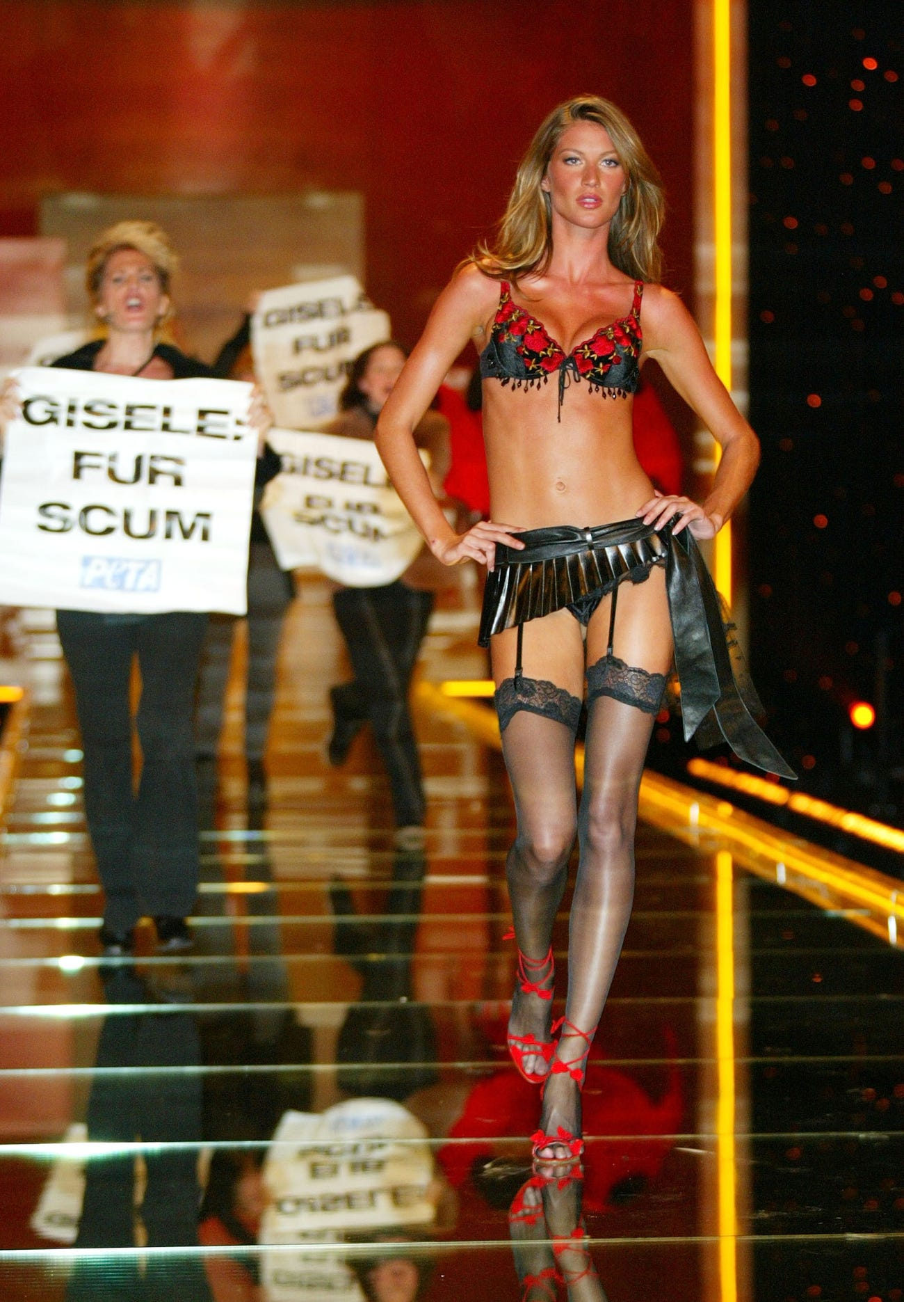 Animal rights protesters storming the catwalk in 2002