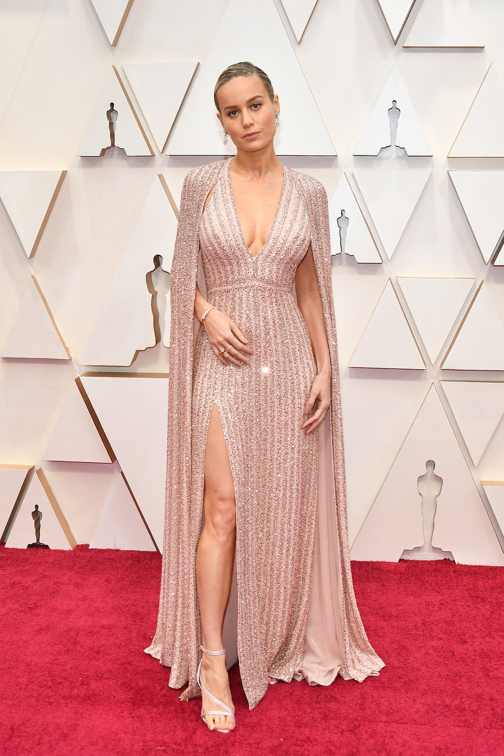 Caped Crusaders and Hooded Gowns Kept the Oscars Red Carpet Interesting