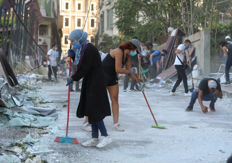 Young people cleaning streets of beirut